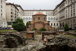 "he Church of St George (??????? ""????? ??????"" or Rotonda ""Sveti Georgi"") is an Early Christian red brick rotunda that is considered the oldest building in Sofia, the capital of Bulgaria. The rotunda has a diameter of 9.5m and is about 14m high. It's brick walls are an impressive 1.40m thick. The building is situated amid remains of the ancient town of Serdica. Built by the Romans in the 4th century CE, it is mainly famous for the 12th-14th century frescoes inside the central dome. Three layers of frescoes have been discovered, the earliest dating back to the 10th century. Magnificent frescoes of 22 prophets over 2 metres tall crown the dome. The original function of the rotunda is still debated. Some say it was built as a bath (or kaldarium), others argue that since it was located in the centre of 2nd century AD Roman public buildings, it likely had a religious and ceremonial function. Emperor Constantine the Great turned the Rotunda into a Christian temple, which surived until the invasion of Attila's Huns, when it was almost completely destroyed. It was reconstructed during the reign of Emperor Justinian. During the reign of sultan Selim I (16th century), the church was turned into a mosque, the 'Gyul Mosque'. A minaret was constructed, and the Early Christian art was painted over with Islamic decorative elements. The original frescoes (3 layers) were only uncovered during restoration works in the 20th century."